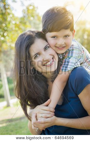Attractive Young Mixed Race Mother and Son Hug Outdoors in the Park.