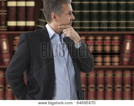 Lawyer businessman in front of bookcase
