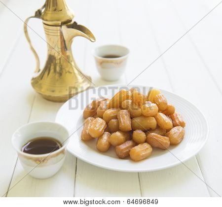 A middle eastern sweet and traditional coffee set
