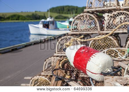 Piles of lobster traps with buoys on the wharf in rural Prince Edward Island, Canada.