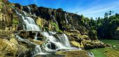 picture of lats  - Tropical rainforest landscape panorama with flowing Pongour waterfall under blue sky - JPG