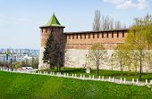 foto of ravines  - Powerful round tower rising at the corner of the mountainous area of the Kremlin over a ravine - JPG