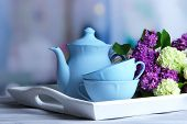 pic of spring break  - Composition with tea set and bouquet of beautiful spring flowers on tray - JPG