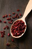 foto of barberry  - Spice barberry in spoon on wooden background - JPG