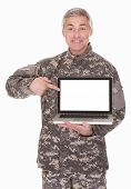 stock photo of soldier  - Mature Soldier Showing Laptop Isolated On White Background - JPG