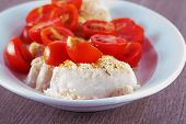 picture of hake  - Hake au gratin with tomatoes over white plate - JPG