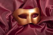 pic of pantomime  - Golden carnival mask on red satin background  - JPG