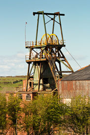 stock photo of ore lead  - Pit head winding gear iconic colliery or mine workings  - JPG