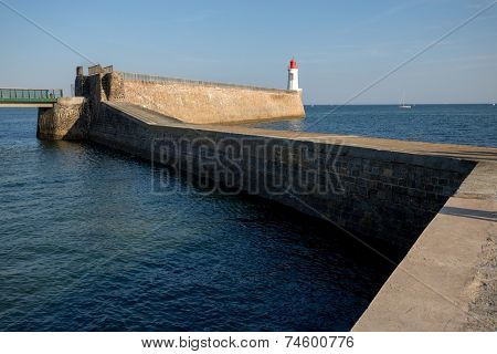 Zigzag pier and lighthouse in a maritime port