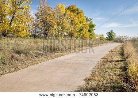 paved bike trail along the Poudre River in Fort Collins, COlorado, fall scenery