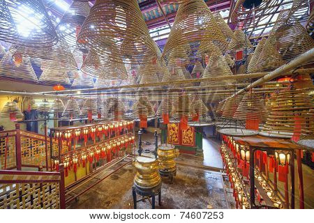 HONG KONG, CHINA - MAY 17, 2014: The interior of Man Mo Temple. Established in 1847, the temple is dedicated to the civil god Man Cheong and the martial god Kwan Tai.