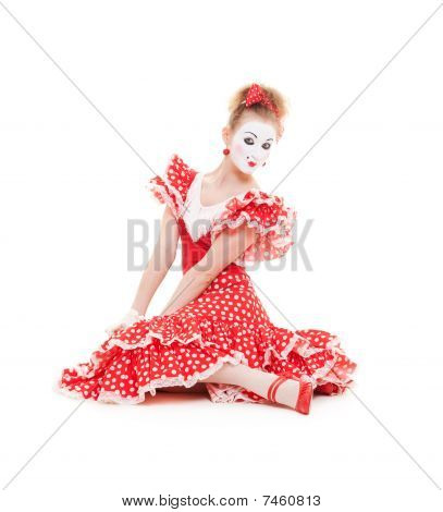 Beautiful Mime In Red Dress Sitting On The Floor