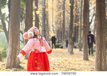 little girl dress new year  costume and enjoy outdoor  in forest