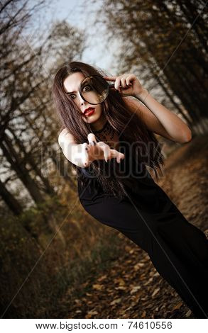 Strange Goth Girl Holds Looking Glass In Hand