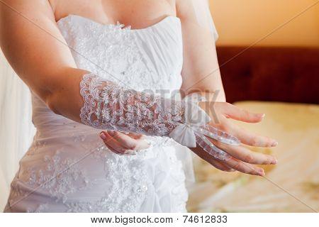 Bride Wears Wedding Gloves