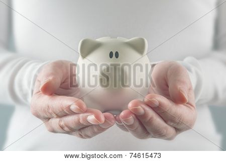 Woman Holding White Piggy Coin Bank