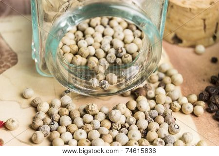 white  pepper in their glass container