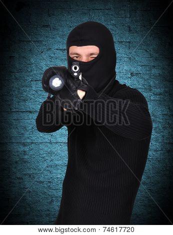 Terrorist With Gun And Flashlight