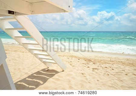 White Lifeguard House On A Beach