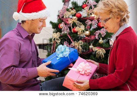 Family Giving Themselves Wrapped Christmas Gifts