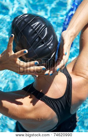 Blue Polish Nails Swimmer Placing Cap