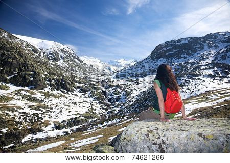 Sitting Woman At A Snow Valley