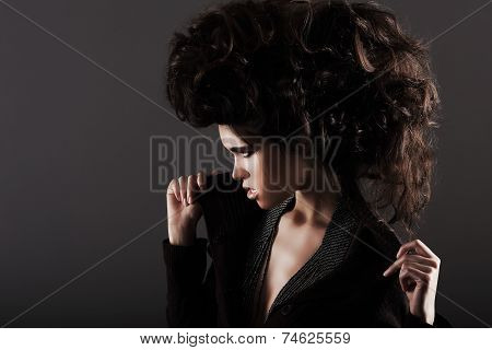Updo. Eccentric Woman With Styled Curly Hairs
