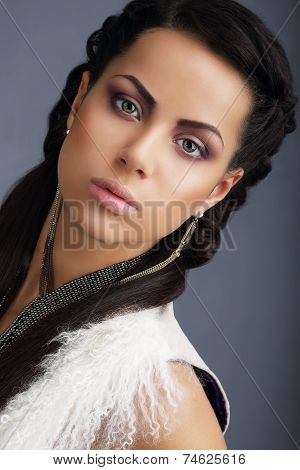 Fascination. Face Of Young Nice Looking Brunette With Earrings