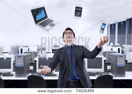 Businessperson Juggling With Business Items