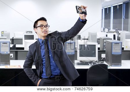 Cheerful Entrepreneur Taking Self Portrait