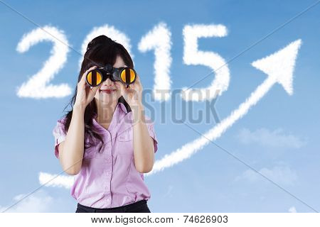 Businesswoman With Binocular And Upward Arrow