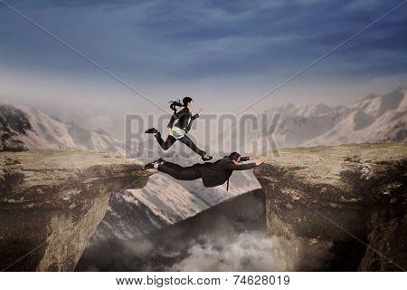 Female Entrepreneur Above Cliff With Partner