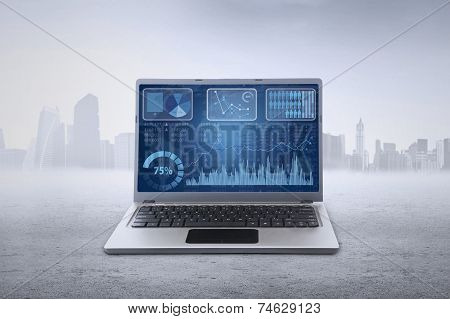 Financial Chart On Laptop Screen Outdoors
