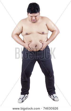 Overweight Person Holds His Belly
