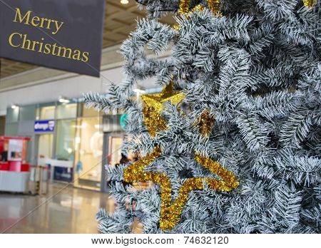 Close Up Of A Grey And Gold Christmas Tree In A Mall Aisle