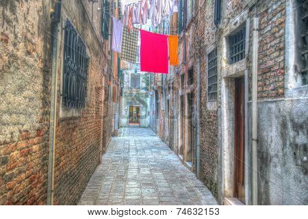 Narrow Street With Laundry Clothes In Venice, Italy