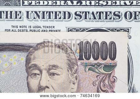 Close - up Japanese bank note and dollar bank note