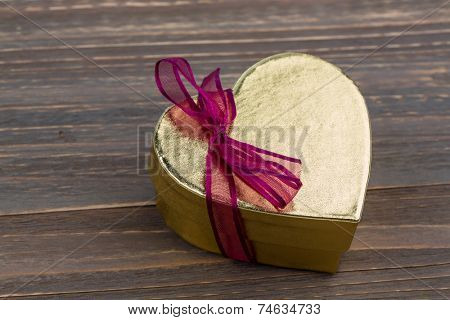 a box for a gift in the shape of a heart. symbol photo for valentine's day, wedding anniversary, engagement.