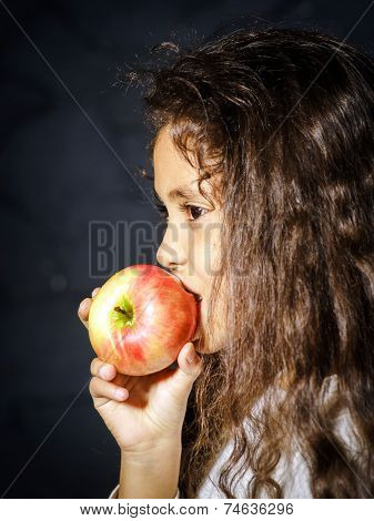 Cute Little African-american Girl With Red Apple