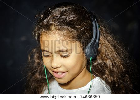 Cute Little African-american Girl Listening Music