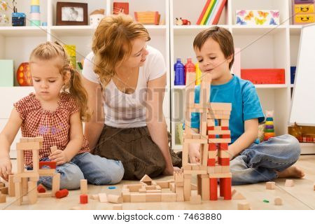 Building With Wooden Blocks Together Is Fun
