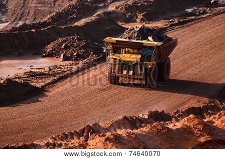 ARKHANGELSK, RUSSIA - OCTOBER 10, 2014: Closeup Of A Loaded Tip-truck In An Open Mine in Arkhangelsk