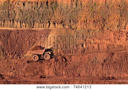 Loaded Tip-truck Going Up Along The Open Mine Wall