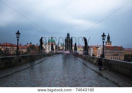 Homeless begs for money on Charles bridge, Prague