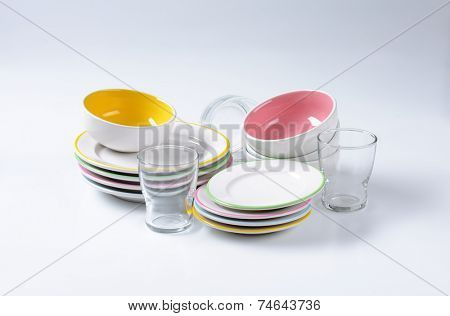 set of porcelain dinnerware consists of plates, bowls and glass