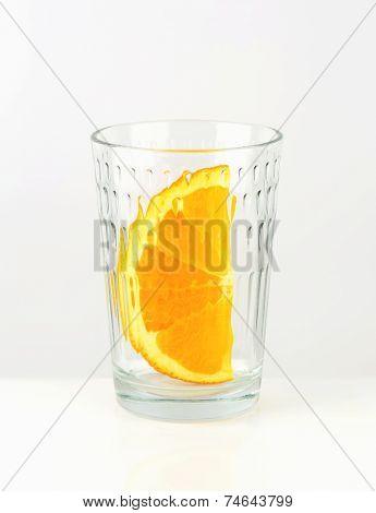 Orange wedge in empty glass