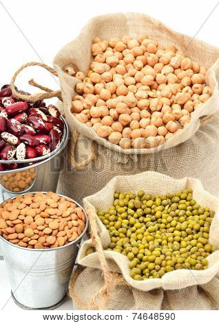 chick-pea mung beans kidney-beans in the sacks isolated on white