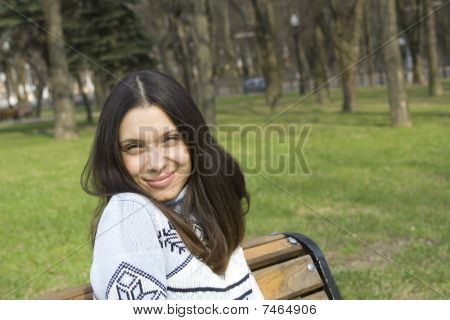 Portrait of beautiful brunette in a park