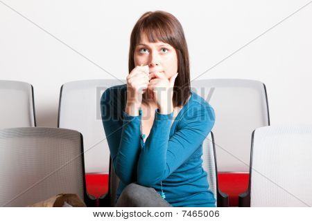 Sad Young Woman Holding Tissue On Her Face