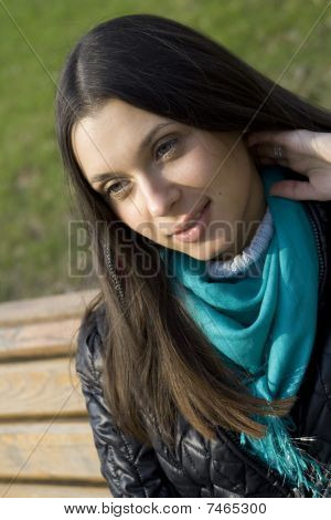 Beautiful girl in a park smiling